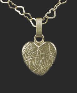 Gouden hartvormige hanger met vingerafdruk