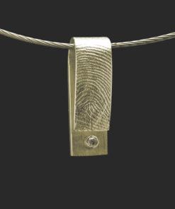 Gouden hanger met vingerafdruk